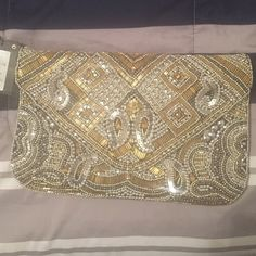 Handbag Gold clutch hand bag never been worn. Didn't see the need of it anymore. Atmosphere  Bags Clutches & Wristlets