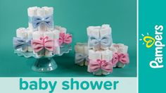 Learn how to make mini diaper cakes, the perfect centerpiece for a gender reveal baby shower. All you need is Pampers diapers, some pink and blue bibs and a ...