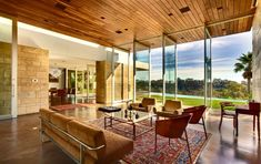 Ehrlich  architects - carrillo residence - raked ceiling, floor to ceiling glass, natural materials