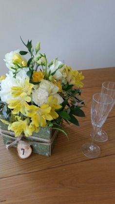 Yellow Alstromeria, white Dianthus, Avalanche  roses & Lisianthus, rustic crate & natural hessian ribbon, log slice table number