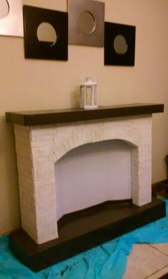 Fake fireplace made out of cardboard. More