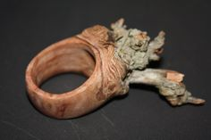 """Ring I carved out of a bottlebrush burl ball I got out of a tree in front of Julia's mom's house. This is for Frank over at http://damcaster.com as a Mirkwood Elf ring. Had to update this as Frank rightly pointed out Treebeard!!!! absolutely this looks like an Ent. I have made a few more of these """"Ent Rings"""" and will post them later."""