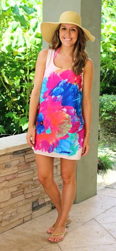 Pack a colorful tank shift dress when traveling to the water this season. Bright bikini straps add a fun detail to your overall look. Wear a pair of wedges for brunch by the bay