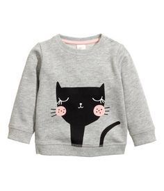 Gray/cat. Long-sleeved top in soft sweatshirt fabric with snap fasteners on one shoulder and ribbing at neckline, cuffs, and hem.