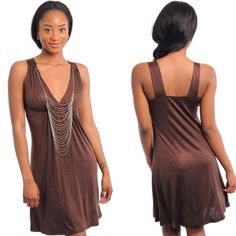 Sleeveless Shimmer Brown Mini Dress w/ Necklace New with tags. Sleeveless v-neckline, a-line brown dress featuring a shimmery semi-stretch fabric and attached tiered necklace. Available in S, M, and L.                                                                92% polyester, 8% spandex.                                            Made in USA.                                                                  Available 4/25. Boutique Dresses Mini