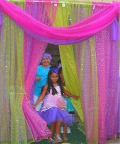 Sparkle sheer curtains on a tension rod inside or outside for the perfect dress up fashion show entrance