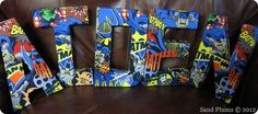 DIY your kid's name in superhero letters.   23 Ideas For Making The Ultimate Superhero Bedroom