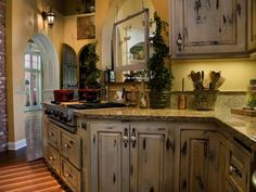 Distressed kitchen cabinets can add a touch of well-worn charm to your cooking space.
