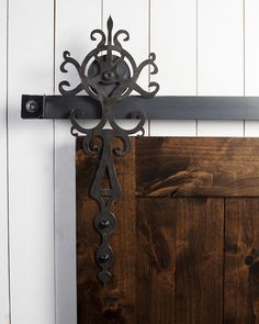 Ornate and rich in detail, the Royal™ hanger is one of our most elaborate designs and adds a regal sense of elegance to any barn door. This stately piece mounts to the front of the door. Current Lead Times For Hardware: 7-10 Business Days. Pictured With: Color / Finish: Raw Steel Wheel Type:MKII Slyder Black