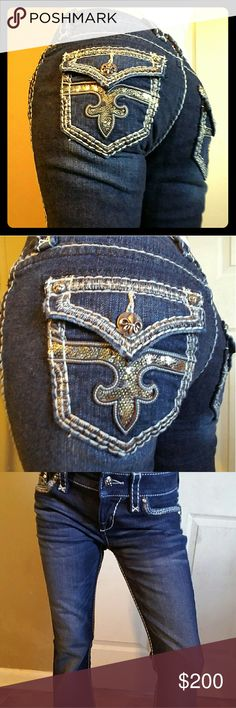 RARE SIZE 26X32.5 ROUX BOOT CUT ROCK REVIVALS! True to size but can measure waist if needed.. Brand new without tags! Never worn besides for pictures of course. Lol.😊 Love these but they're a lil to loose on me.  Black/Silver Rock revival plate. Sorry I'm a lefty so didn't picture that but can if requested.   Check out my VSPINK ISO's if interested in trading. Rock Revival Pants Boot Cut & Flare