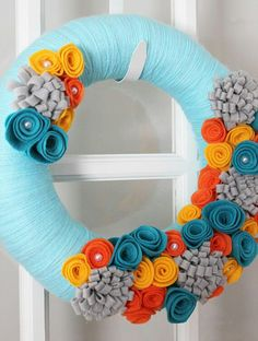 Love the Coloring! Light Blue, Orange, Grey, Golden, Deep Blue Floral Yarn Wreath from Etsy.com: TheLandofCraft