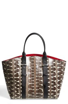Alexander McQueen's genuine snakeskin leather shopper definitely makes a bold graphic statement.