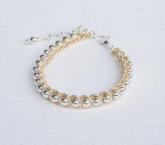 Silver and gold chainmaille bracelet