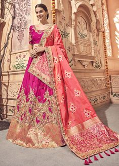 Rani pink and coral pink lehenga choli with dupatta. Work - Heavy embroidery work on lehenga, choli and dupatta. To complete the look matching choli and dupatta is available with this product. Lehenga Choli Online, Ghagra Choli, Bridal Lehenga Choli, Banarasi Lehenga, Beautiful Bridal Dresses, Nice Dresses, Pink Lehenga, Party Wear Lehenga, Indian Ethnic Wear