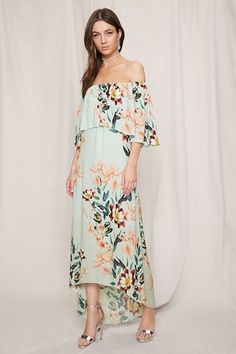 This Pretty By Rory™ midi dress features a floral-printed chiffon fabric, an off-the-shoulder neckline, flounce layer short sleeves, and a billowy silhouette.