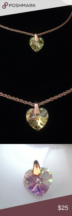 Beautiful vintage single crystal heart pendant EVC Notice how it changes color, depending on what its near. Just gorgeous! Lots of flash and fire.  Gold, light yellow, light green, a little pink and blue jump out when it moves in the light I have 2 others with slightly different bails, which can be made into a pair of earrings, which would look great with this necklace. I have included a pic of all 3 together. If you don't see a listing for the earrings, please ask me. Chain is gold plated…