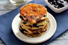 Protein-packed pancakes are filled with plump blueberries, vanilla Greek yogurt and just the right amount of flavor for an awesome breakfast.