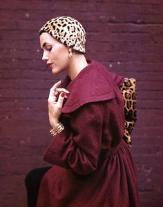 https://flic.kr/p/8LwKa3 | New York 1949 | Model is wearing a plum-colored jacket and jaguar hat designed by Pauline Trigère.  Image by Genevieve Naylor/CORBIS