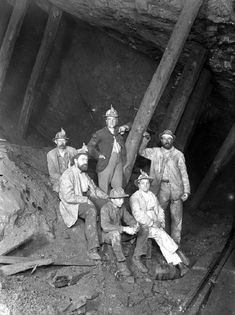 Victorian Mining: group of miners underground wearing tull hats and candles Cornish Tin Mines, Coal Miners, Victorian Photos, Cornwall England, Historical Images, Poldark, British History, British Isles, Vintage Photographs