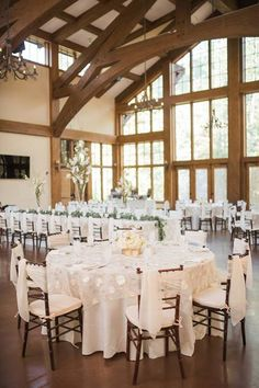 """We love these photos by Julie Afflerbaugh Photography of Shannon & Brian's wedding in Vail this July featuring our beautiful """"Peony"""" overlay linen in Ivory-Gold. Definitely adds a soft floral touch to their natural-inspired event design accented by blues and soft pinks next to our classic Duchess Satin in White. https://www.facebook.com/MileHighCelebrations/posts/942684902473371 — at Donovan Pavilion.12347978_10153145821485178_4051653927728772954_n.jpg (480×720)"""