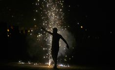 Firecracker silhouette during Diwali. Photography by Rafiq Maqbool, via The Big Picture. #rafiq_maqbool #diwali #india #light #silhouettes #firecrackers #shadows #sparks