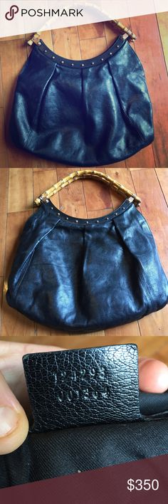 "Authentic Gucci Bag w/ bamboo handles Black leather authentic Gucci bag with bamboo handles. Has copper looking studs at bags opening. From top of handle to bottom of bag is 19"". Bottom width 16"" opening to bottom of bag 12"".  It's in really good condition, I hardly used it.  I no longer have the dust bag.  I will post additional pics on a separate listing to show details and inside.  Serial # is 124293 001364. Please feel free to ask additions ?'s. Gorgeous bag. Gucci Bags Shoulder Bags"