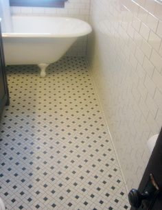 Flooring Ideas Black Detail White Bathroom Mosaic Floor Tile With Wooden Door And Freestanding Bathtub Also Wall
