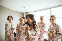 The beautiful bride in our Liv floral robe matched with her Maids in the Zariah floral robe. #bridalrobes #florals #springwedding #champagne #bridal