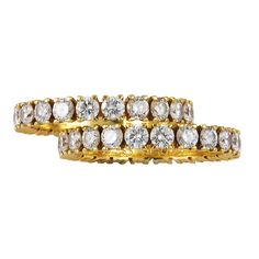 CARTIER Paris pair of Diamond Eternity Bands | From a unique collection of vintage band rings at http://www.1stdibs.com/jewelry/rings/band-rings/