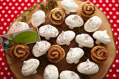 """mushrooms    Make """"toadstools"""" by arranging cocoa-dusted meringue cookies with mini-marshmallow """"mushroom stems"""" on a wooden tray with mini cinnamon rolls"""