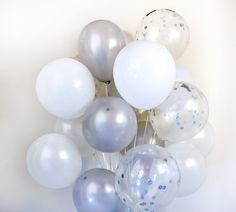 Check out this item in my Etsy shop https://www.etsy.com/listing/494845602/white-silver-confetti-balloon-bouquet