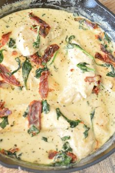 Creamy Tuscan Garlic Chicken is bursting with flavors of garlic, parmesan and garnished with spinach and sun dried tomatoes. A Teaspoon of Home