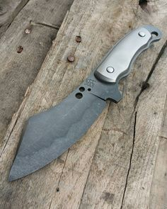 Toukan in 1095 with hamon , acid stonewashed and titanium handles. - looks like the maker's mark says Koch.