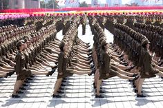 North Korea. Talk to students about the uniformity of different armies. North Korea v. South Korea.
