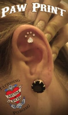 Paw print piercing! It would be the perfect dermal!!! Omg I found my birthday project!