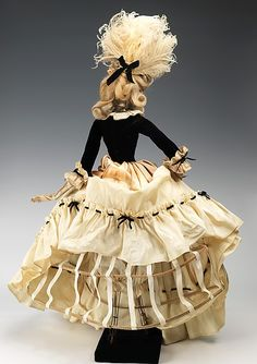 """""""1774 Doll""""  Jean Dessès (French, born Eqypt, 1904–1970)  Designer: Gervais Date: 1949 Culture: French Medium: metal, plaster, hair, silk, feather, leather, glass, cotton Dimensions: 34 x 19 in. (86.4 x 48.3 cm) Credit Line: Brooklyn Museum Costume Collection at The Metropolitan Museum of Art, Gift of the Brooklyn Museum, 2009; Gift of Syndicat de la Couture de Paris, 1949"""