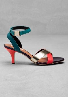 & OTHER STORIES These sandals have a slender scuba ankle strap with a gold snap buckle and a lightly padded leather front strap. A covered heel, cushioned leather insole, leather sole and triangular rubber heel tip complete the style. Heel height: 7 cm.