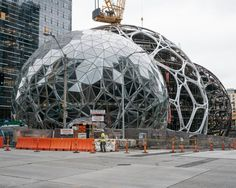Amazon is building a complex at its Seattle headquarters where employees can sit by a creek, walk on suspension bridges and brainstorm in the boughs.