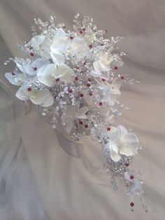 White orchids trailing bouquet with red and clear crystals . 12 x 22 inches £225.00
