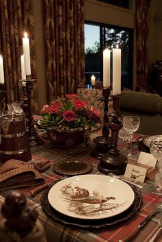 Elegant look for a decorated table for  Thanksgiving through Christmas. Leave the plaid tablecloth, centerpiece, and candlesticks for both holidays; change out the plates,  napkins, add a little more glitter for Christmas.....