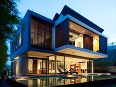 Sentosa house in here is made in the purpose to bring outside views into inside the home. Description from bodew.com. I searched for this on bing.com/images