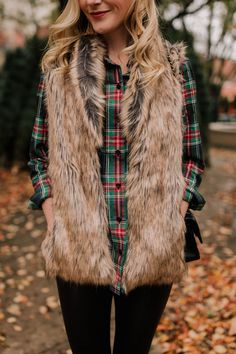 Faux fur vest paired with plaid long sleeve button down. #fauxfur #winterstyle #fashion