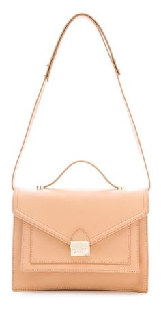 Loeffler Randall The Rider Bag - a classic satchel silhouette in natural vachetta leather.