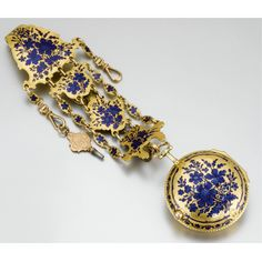 PERIGAL A GOLD AND ENAMEL VERGE WATCHWITH CHATELAINE LONDON, CIRCA 1770, NO.623  full plate movement with masked balance cock, signed Perigal 623 London SS, white enamel dial with winding aperture (chipped), gold beetle and poker hands, the case decorated with blue champlevé enamel decoration restored, matching chatelaine with pendant chains, associated key, gilt metal hook with short metal chain