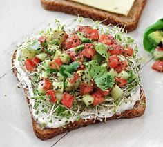 Avocado Salad 1 avocado, peeled, pitted and diced 1 tomato, cored and chopped 1 cucumber, peeled, seeded and diced Squeeze of lime juice 2 tablespoons chopped fresh basil or cilantro Salt and pepper, to taste 4 slices whole grain bread or 4 small mulitgrain tortillas 1/4 cup alfalfa sprouts 2 to 4 slices lite pepper jack cheese spread cream cheese (with chives) on bread as a base
