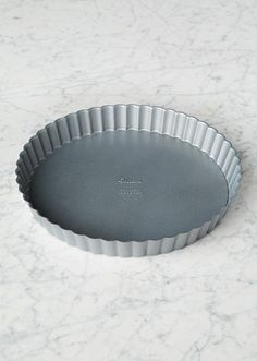 """French pastry chefs have long relied on fluted pans like this one to create beckoning tarts with tender golden crusts. A nonstick finish keeps the pastry intact, while a removable bottom helps it slip out easily onto a serving plate. P.S.- This 9"""" Tart Pan is the perfect fit for our Lemon and Strawberry Tart kits! See what else we're cooking at redvelvetnyc.com"""