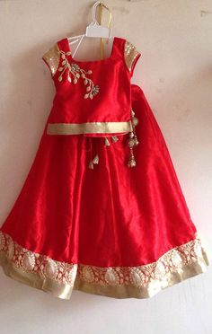 Red silk lehenga with flower applique and sequin by Bubblinga