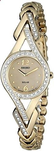 Seiko Women's SUP176 Swarovski Crystal-Accented Stainless Steel Solar Watch. Go to the website to read more description.