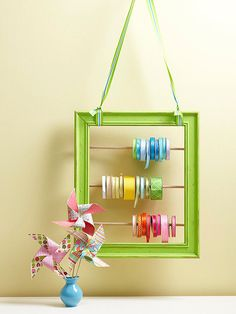 Pretty Ribbon Storage Discover new (and deocrative!) storage ideas for your ribbon, twine, and trim.
