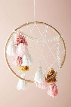 Tasseled Dream Catcher, presented by Anthropologie. Your little one will only have the sweetest of dreams with this delightful dream catcher. With its colorful tassels and delicate poms, it's a precious addition to a nursery or child's bedroom. Dreamcatchers, Boho Dreamcatcher, Diy Décoration, Diy Crafts, Embroidery Hoop Crafts, Embroidery Ideas, Hoop Dreams, Diy Home Decor Bedroom, Dream Catcher Boho